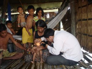 Examining-child-in-village