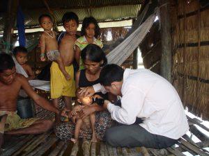 Examining-child-in-village